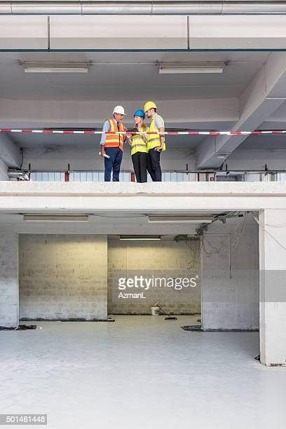 Checking progress on construction site
