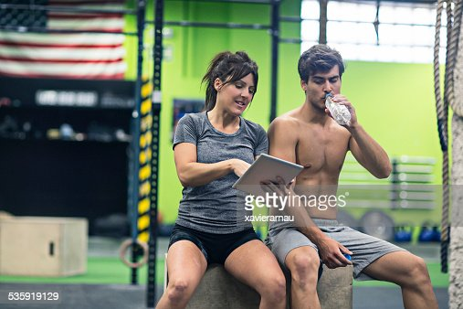 Checking the exercises on the digital tablet : Stock Photo
