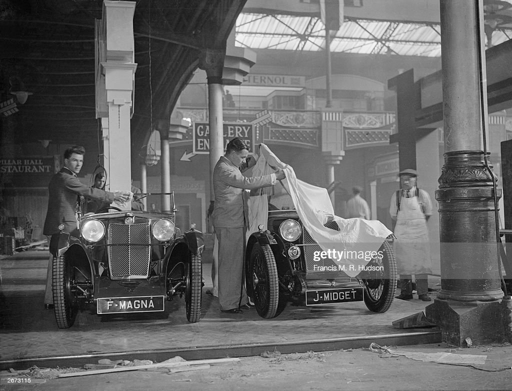 Checking the first arrivals at the motor show in Olympia London The MG Magna and Midget