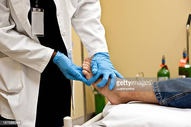 Checking the patient's foot