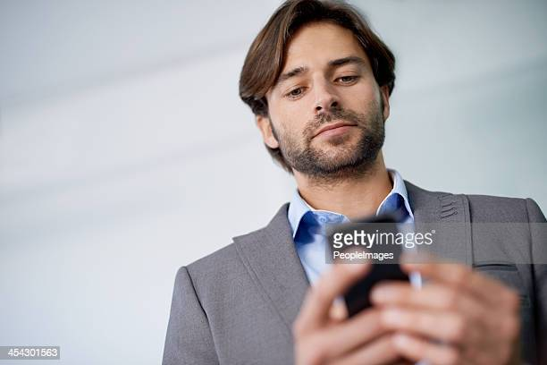 Checking the schedule on his smartphone