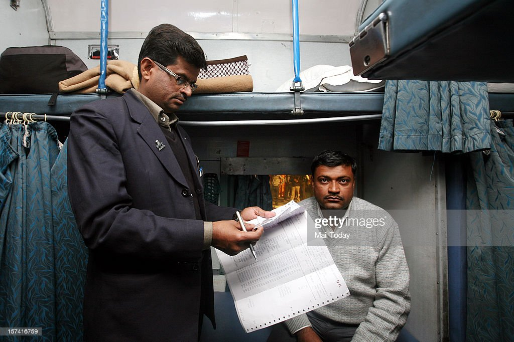 TTE checking tickets along with identity cards in a train at New Delhi Railway Station on Sunday in New Delhi.