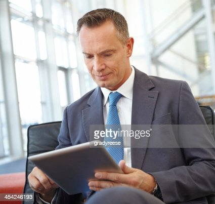 Checking up on his investments : Stock Photo
