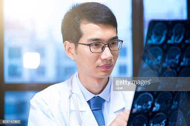 Checking x-ray photo of patients