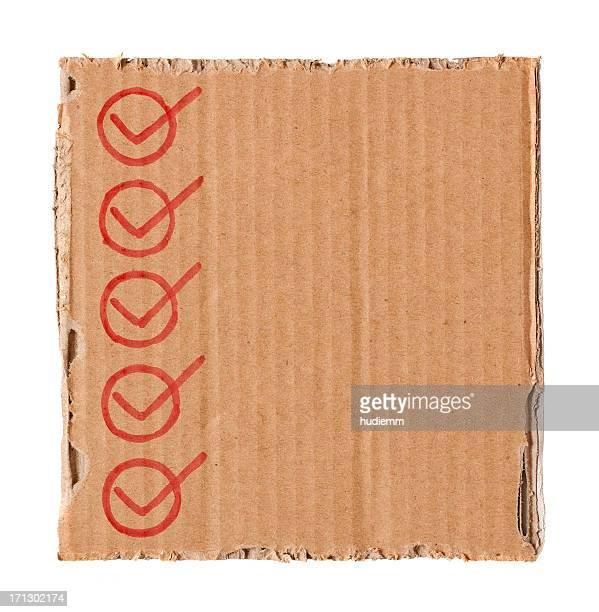Checklist in the cardboard textured background