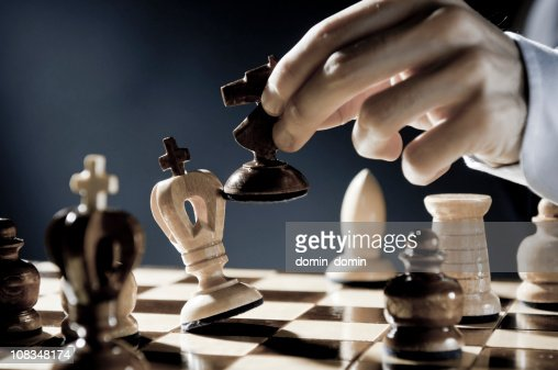 Checkmate Strategy, close-up of chess player, businessman making checkmate move