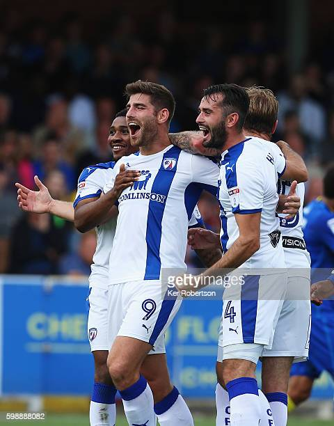Ched Evans and Chesterfield team mates celebrate as AFC Wimbledon concede an own goal thru Darius Charles during the Sky Bet League One match between...