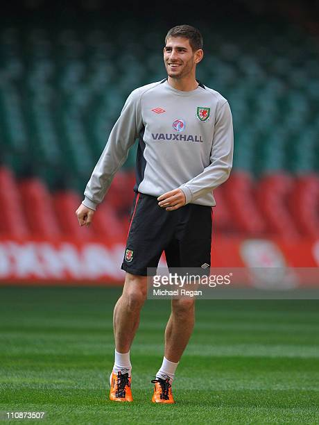 Ched Evans smiles during the Wales training session ahead of their UEFA EURO 2012 qualifier against England on March 25 2011 in Cardiff Wales