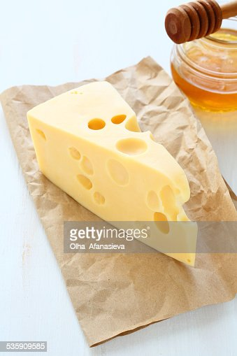 Cheddar cheese on a paper with honey : Stock Photo