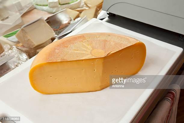 A cheddar cheese wheel