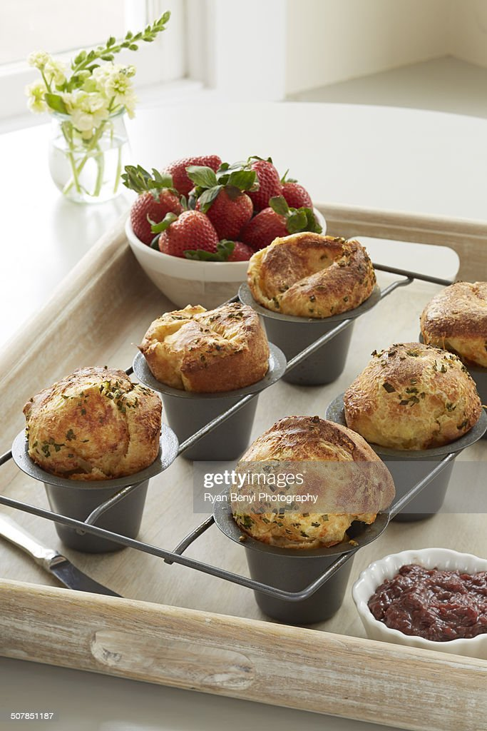 Cheddar chive popovers served with a fresh strawberry chutney : Stock Photo
