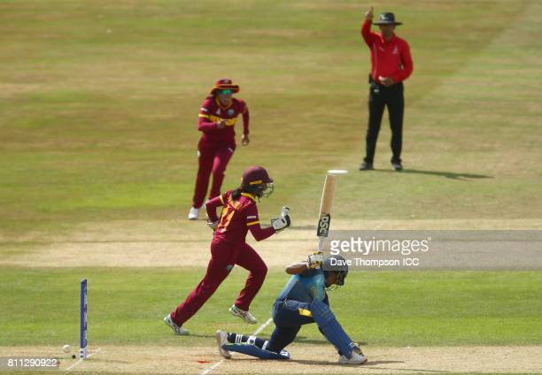 Chedean Nation of West Indies and Merissa Aguilleira of West Indies celebrate after Chamari Athapaththu of Sri Lanka was stumped by Merissa...