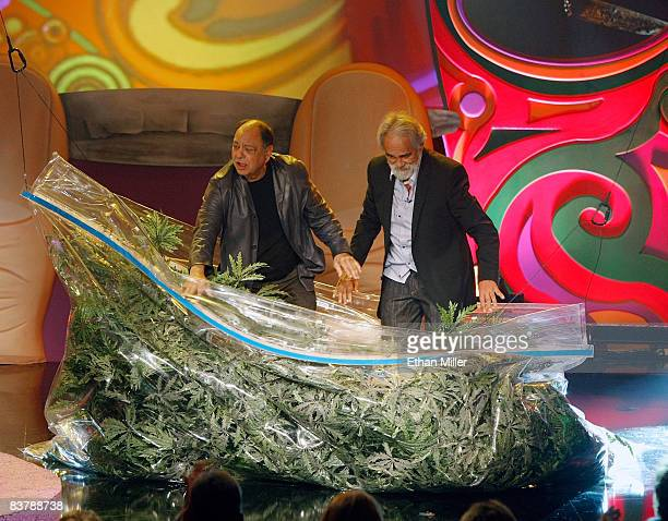 Cheech Marin and Tommy Chong emerge from a prop bag of marijuana as they arrive for their roast at The Comedy Festival at Caesars Palace November 21...