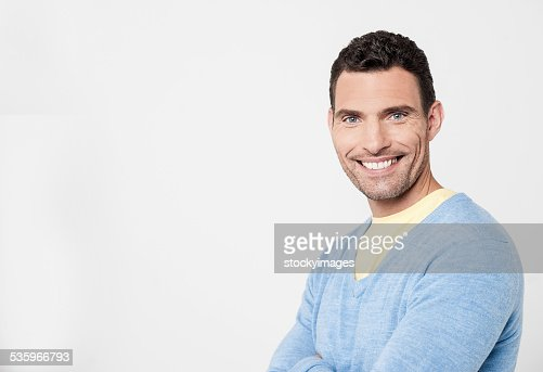 Cheeful man posing with confidence : Stock Photo
