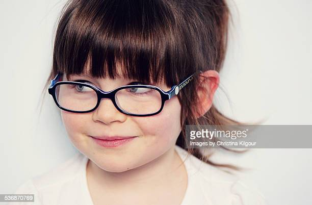 Cheeky little girl wearing glasses