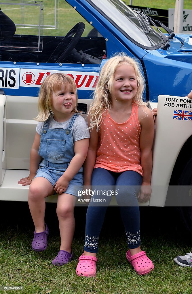 cheeky-mia-tindall-sticks-out-her-tongue-as-she-plays-with-cousin-picture-id607548850