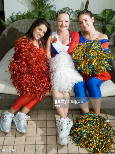 Cheer leaders poses for camera during a photo shoot at Paharganj hotel on April 11 2010 in New Delhi India