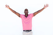 Portrait of cheerful african american man laughing with arms outstretched