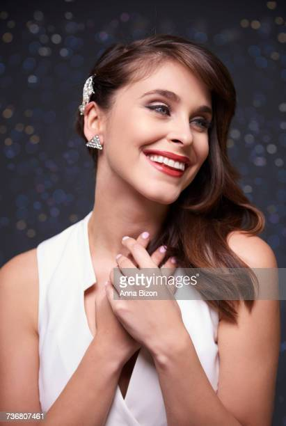 Cheerful and elegant woman on sparkle background. Debica, Poland