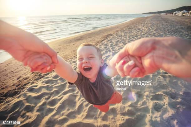 Cheerful babySpinning boy