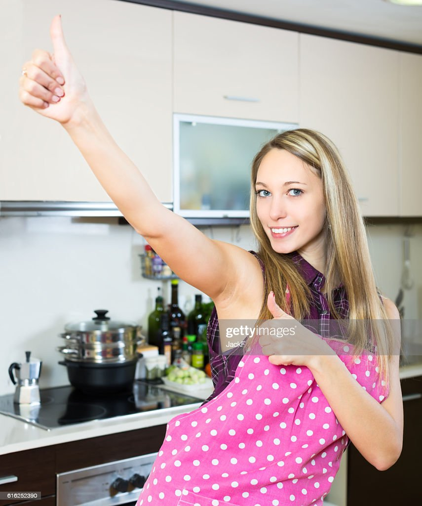 Cheerful blonde with thumbs up : Stock Photo