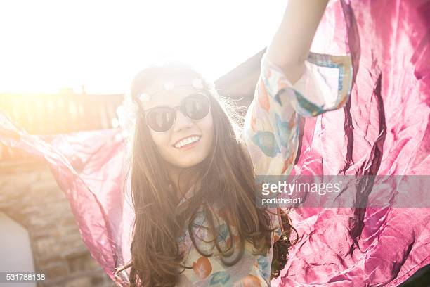 Cheerful boho woman dancing outdoor