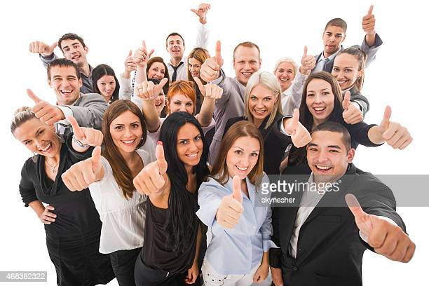 Cheerful business people showing thumbs up. Isolated on white.