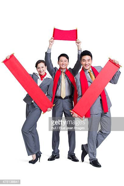 Cheerful business people with couplets celebrating Chinese New Year