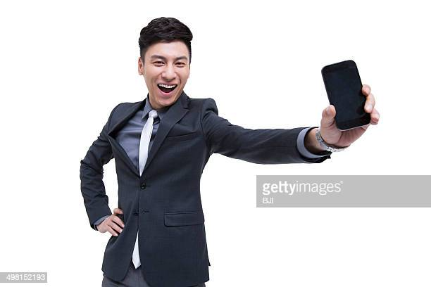 Cheerful businessman being proud of his smart phone