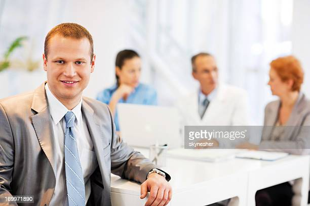 Cheerful businessman having a meeting with doctors.