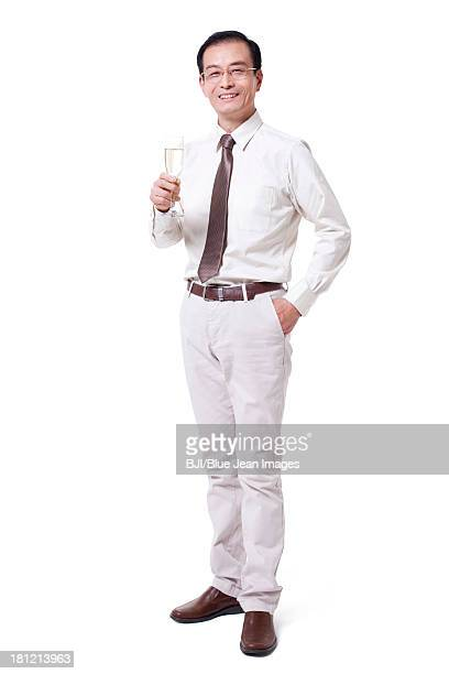 Cheerful businessman holding champagne flute