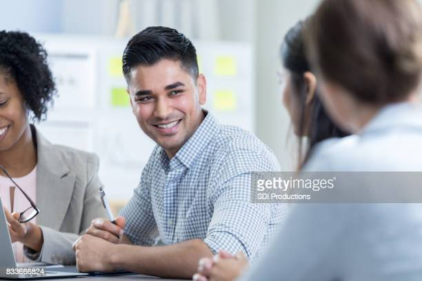 Cheerful businessman in meeting