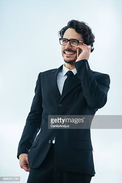 cheerful businessman talking on the phone