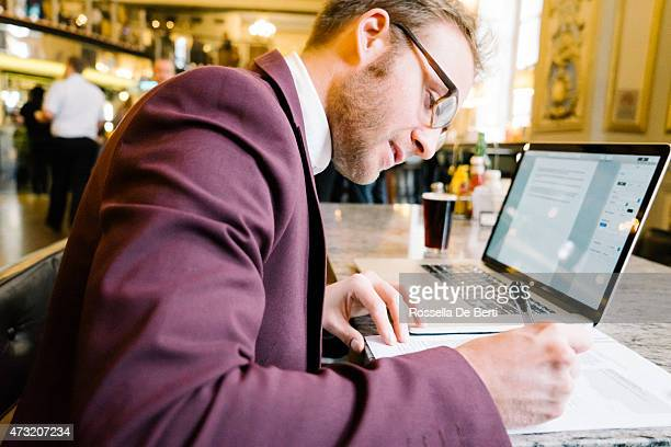 Cheerful Businessman Working In A Coffee Shop