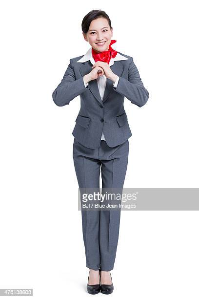 Chinese new year greetings stock photos and pictures getty images cheerful businesswoman offering traditional chinese new year greeting m4hsunfo