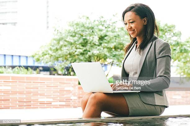 Cheerful Businesswoman Working With Laptop Outdoors