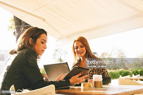 Cheerful Businesswomen Having A Meeting In A Cafè