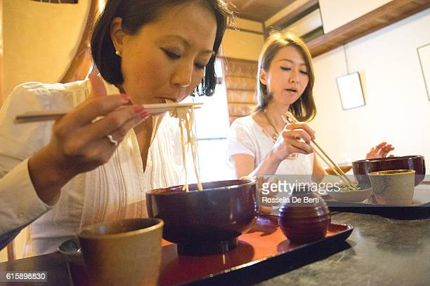 Cheerful businesswomen meeting over lunch in a Japanese restaurant