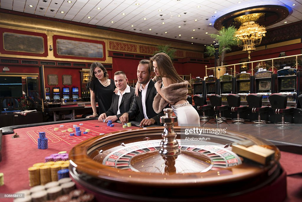 Cheerful Casino Players, Roulette Game, Europe