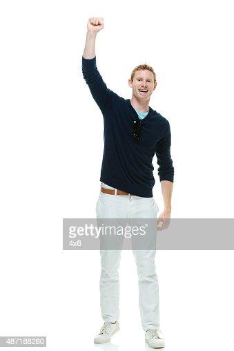 Cheerful casual man cheering