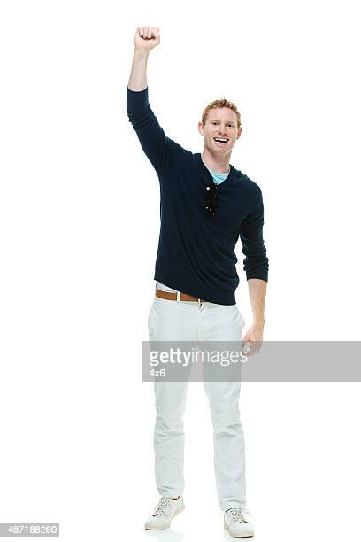 Cheerful casual man cheering