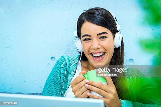 Fröhlich casual woman listening music