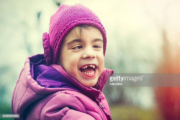 Cheerful child portrait in nature