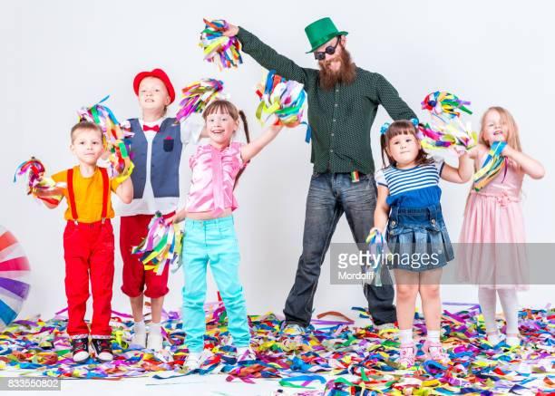 Cheerful Children and Adults Having Fun At Holiday Party
