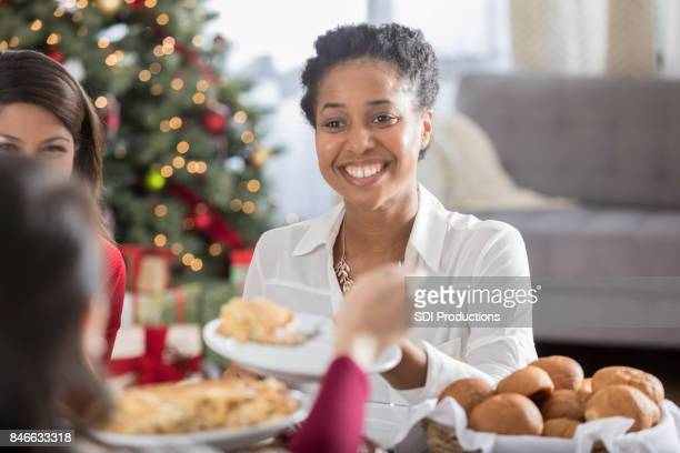 Cheerful Christmas dinner guest is served pie for dessert