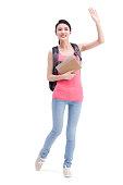 Cheerful college girl waving hand