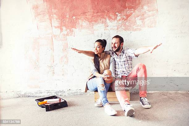 Cheerful couple doing home improvement