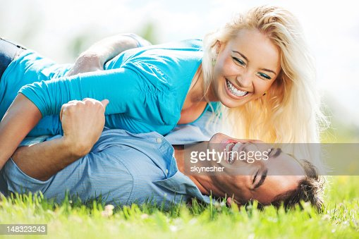 Cheerful couple enjoying in the nature stock photo getty for Cheerful nature