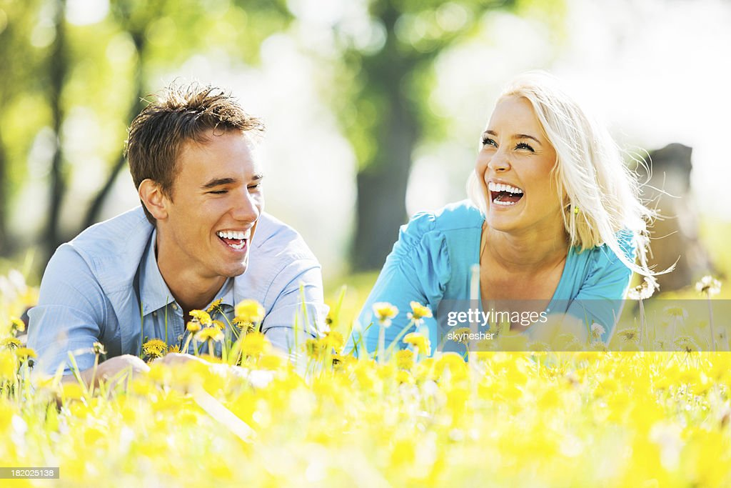Cheerful couple enjoying in the nature. : Stock Photo