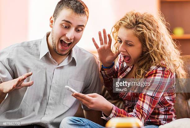 Cheerful couple got positive results on pregnancy test.
